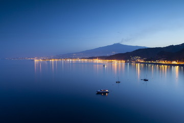 Mount Etna and Giardini Naxos at dusk, Sicily, Italy, Mediterranean, Europe