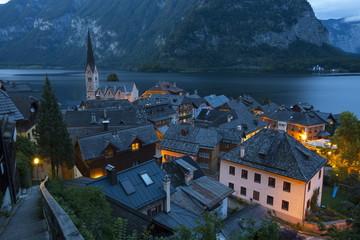 Village of Hallstatt illuminated at dusk, Hallstattersee, Oberosterreich (Upper Austria), Austria