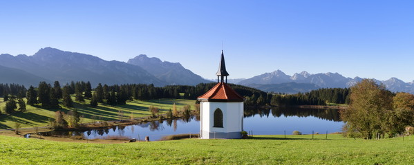 Chapel at Hergratsrieder See lake with Allgau Alps, near Fussen, Allgau, Ostallgau, Bavaria, Germany, Europe