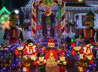 Christmas outdoor Christmas decorations - Snowman and nutcracker lights up house in Brooklyn, New York