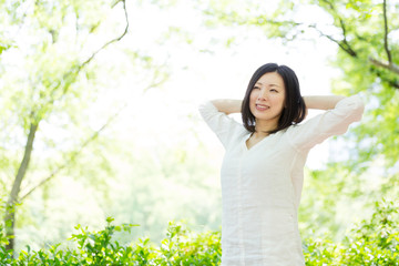 Wall Mural - young asian woman relaxing in the park