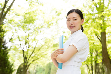 Wall Mural - young asian nurse in the park