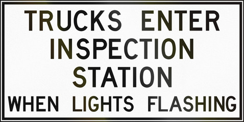 Trucks Enter Inspection Station in Canada