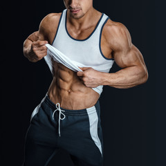 Muscular man in dark background