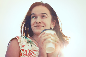 smiling pretty girl with morning coffee in sunlight