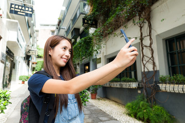 Woman using cellphone for taking photo