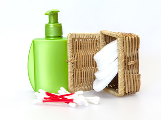 Subjects for care of face skin: wadded disks, Q-tips, lotion bottle