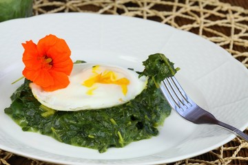 Spinach,  poached egg & edible flower  water cress