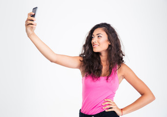 Teen girl making selfie photo on smartphone