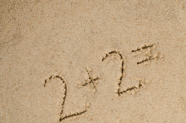 hanwritten numbers on sand