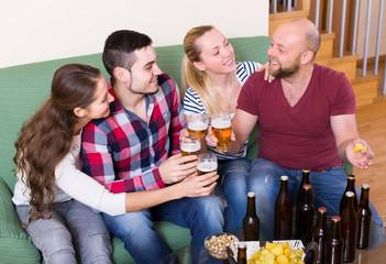 Adults drinking beer indoor