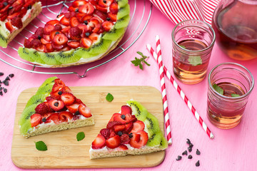 Sponge cake with strawberries and kiwi in shape of watermelon
