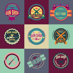 Pop art gun shop logotypes and badges vector set