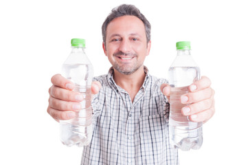 Man giving or offering two bottles of cold water