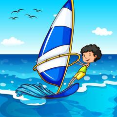 Boy surfing in the ocean