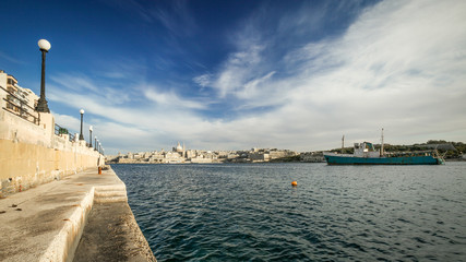 Valletta, Malta. A view over Marsamxett harbor of the skyline of the Maltese capital Valletta dominated by the dome of St. Paul's Anglican Cathedral.