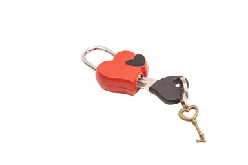 Red heart shaped padlock and keys isolated on white
