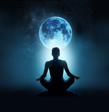 Abstract woman are meditating at blue full moon with star in dark background