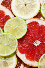 Sliced grapefruit, lemon, lime, food background, top view, selec
