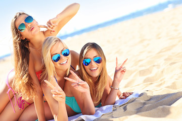 Group of women having fun on the beach