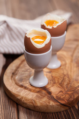 Boiled eggs on a wooden background