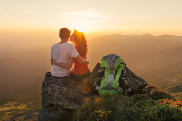 Happy couple enjoy beautiful view in the mountains
