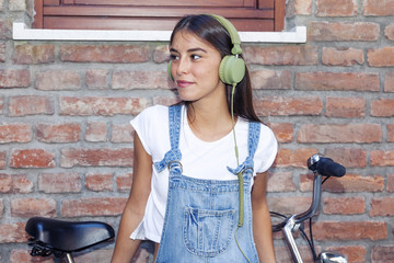 young beautiful woman enjoys music with headphones