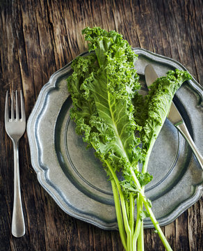 Fresh Green Kale on plate. Healthy eating concept