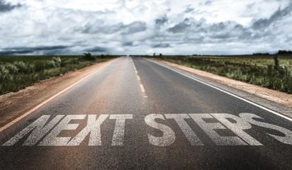 Next Steps written on rural road