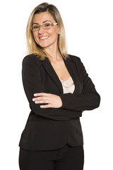 Brazilian businesswoman with arms folded smiling isolated on white background