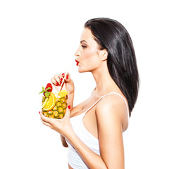 Woman drink tropical cocktail in pineapple with straw