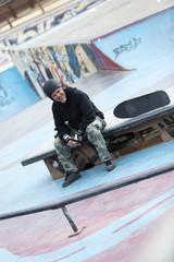 smiling old man skater sitting