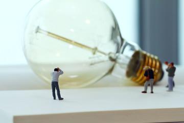 Creative idea concept - miniature photographer with vintage ligh