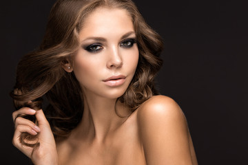 Beautiful woman with evening make-up and long straight hair