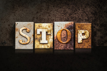 Stop Letterpress Concept on Dark Background