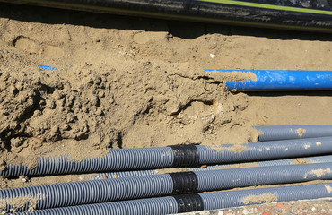 corrugated pipes for laying electric cables in the excavation