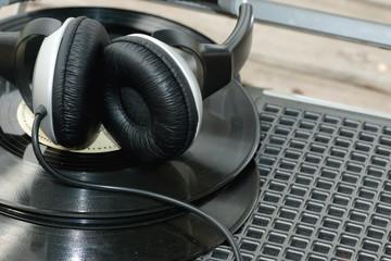 player with headphones on vinyl plates