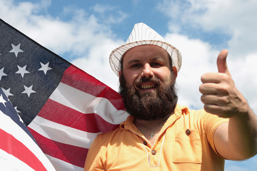 man with a beard with American flag