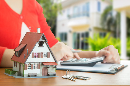 Woman calculate and plan for your good property
