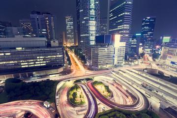 Illuminated traffic loops outside Shinjuku Station, Shinjuku, Tokyo from above at night