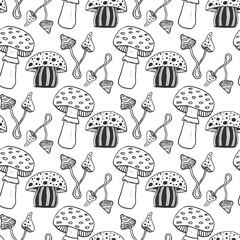 Hand drawn psychedelic magic mushrooms seamess pattern. Doodle vector background with poison mushrooms.