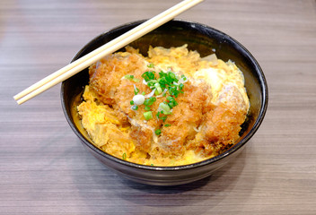 Katsudon - Japanese breaded deep fried pork cutlet (tonkatsu) topped with egg on steamed rice.