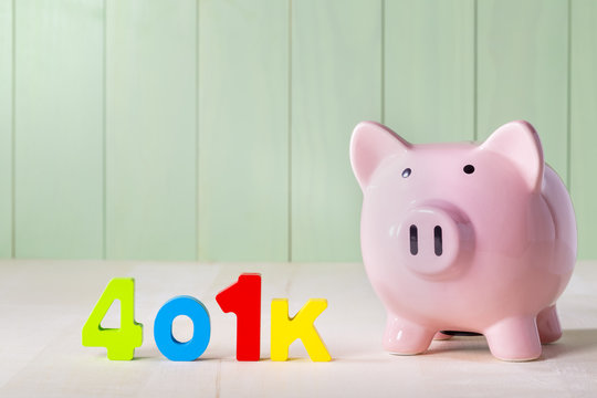 401k retirement account  theme with wood block numbers and piggy bank