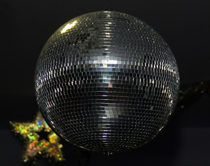 Mirror ball in a club with star on background