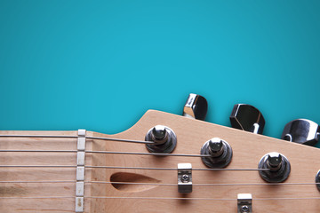 Head of electric guitar on blue background