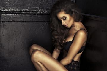 Portrait of sexy brunette woman wearing sensual lingerie