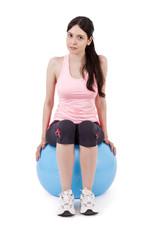 girl sitting on gym ball