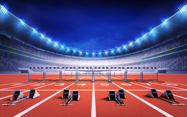 athletics stadium with race track with starting blocks and hurdles