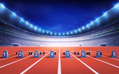 athletics stadium with race track with starting blocks