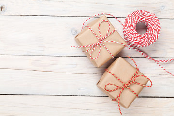 Gift wrapping over wooden table